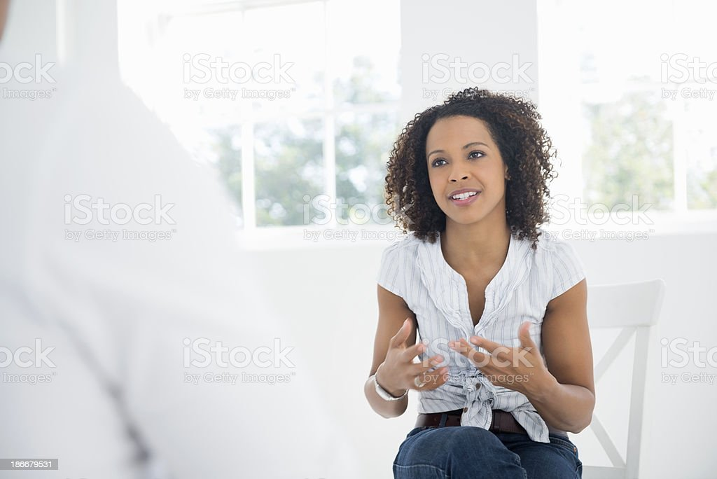 Businesswoman Discussing With Colleague stock photo