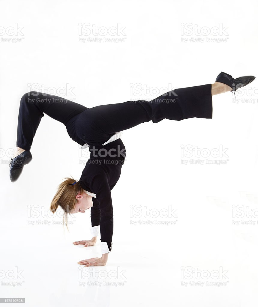 businesswoman doing a hand stand royalty-free stock photo