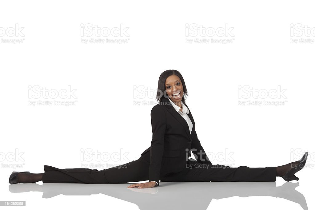 Businesswoman doing the splits royalty-free stock photo