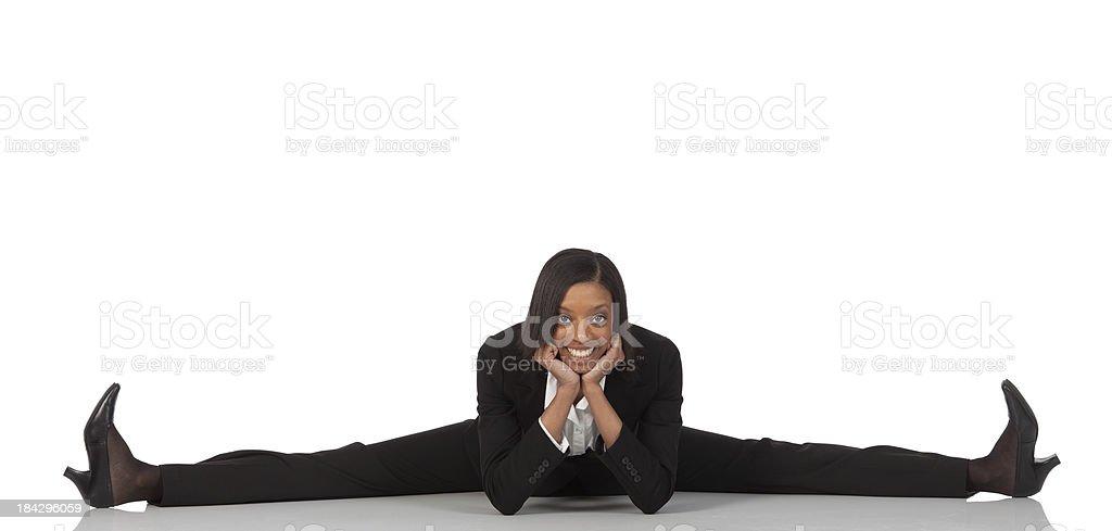Businesswoman doing the splits royalty-free stock photo
