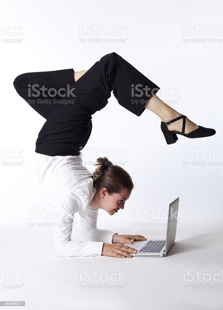 businesswoman doing yoga on laptop royalty-free stock photo