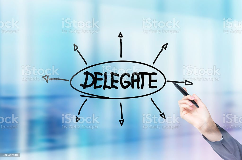 Businesswoman drawing delegating sketch stock photo