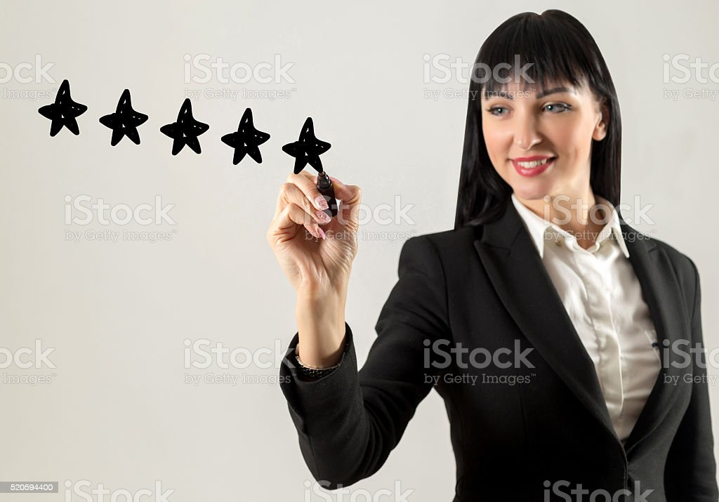 Businesswoman drawing five stars stock photo