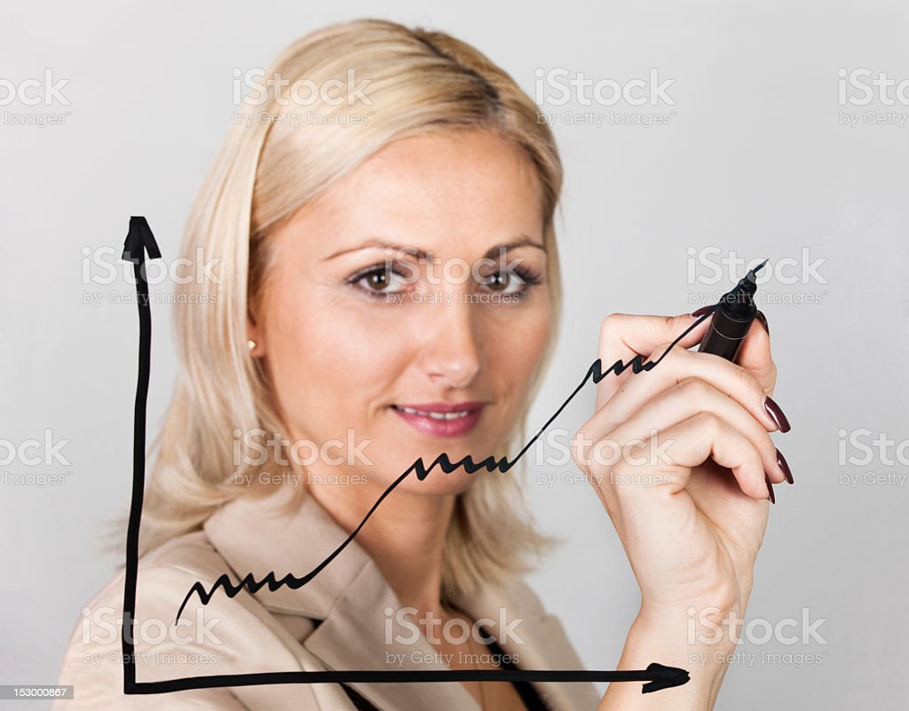 Businesswoman drawing growth chart royalty-free stock photo