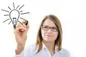 Businesswoman drawing Lightbulb