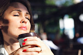 Businesswoman drinking coffee in cafe