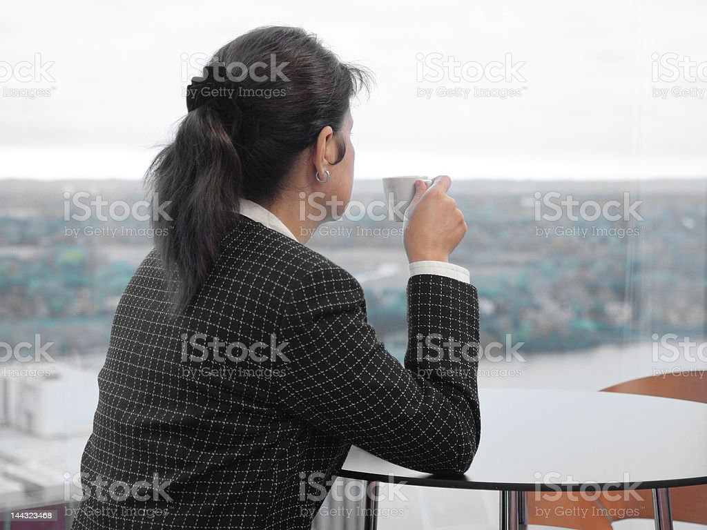 Businesswoman drinks coffee in cafeteria royalty-free stock photo
