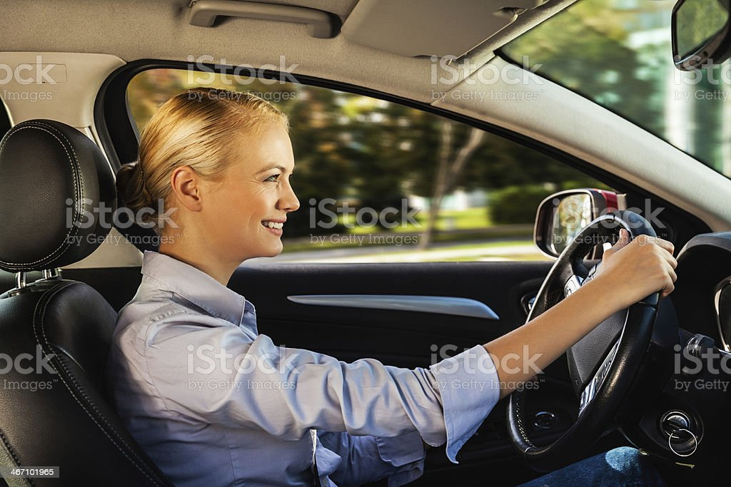Businesswoman driving car royalty-free stock photo