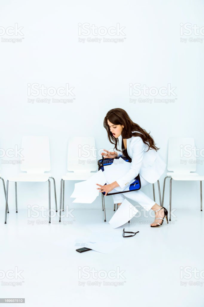 Businesswoman dropping files stock photo