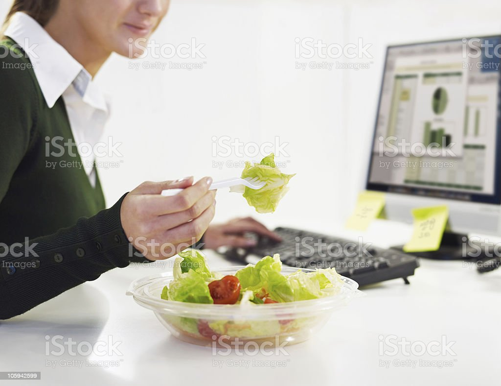 businesswoman eating salad stock photo