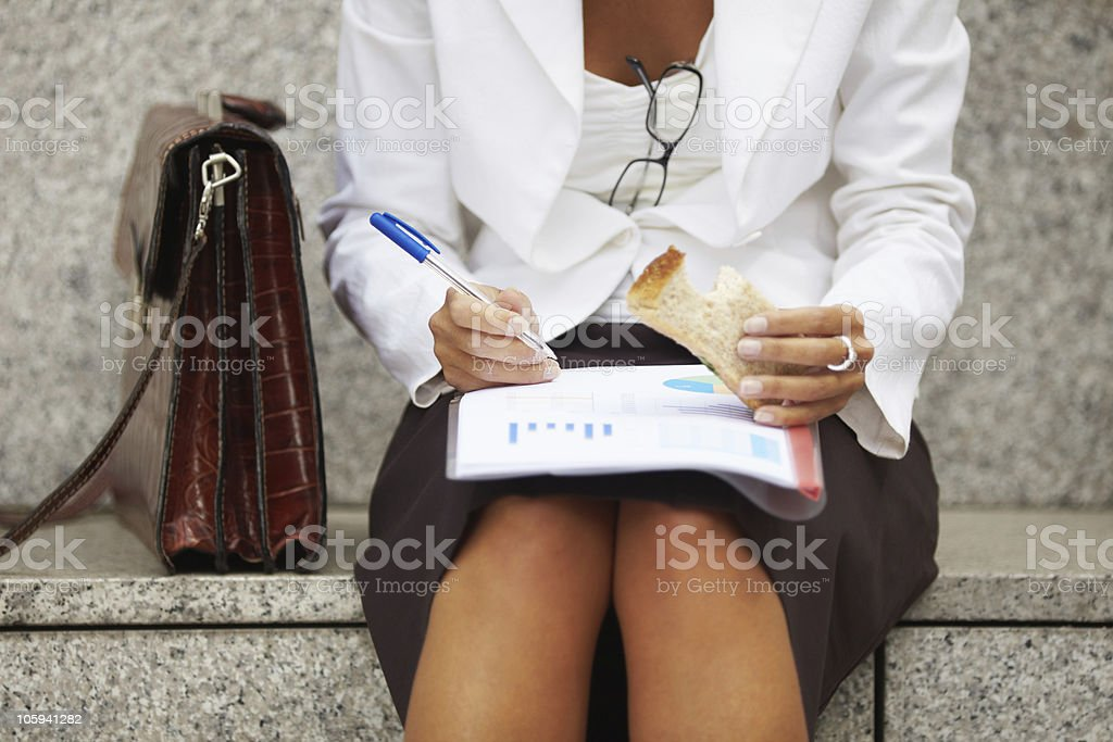 businesswoman eating sandwich royalty-free stock photo