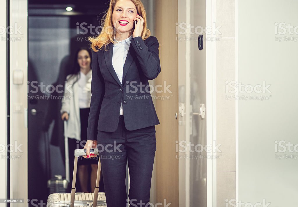 Businesswoman entering hotel room stock photo
