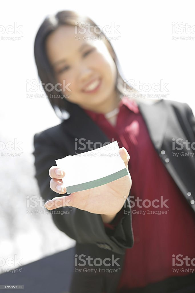 Businesswoman Extending Business Card royalty-free stock photo