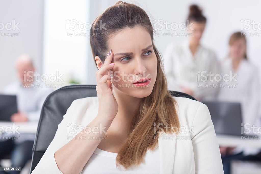 Businesswoman feeling bad at work stock photo