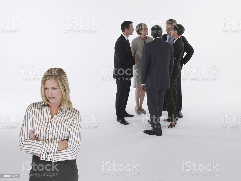 Businesswoman feeling left out stock photo