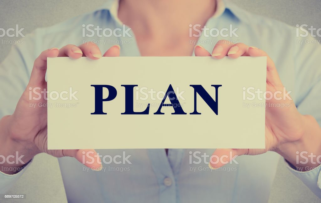 businesswoman, female hands holding white sign or card with message plan stock photo