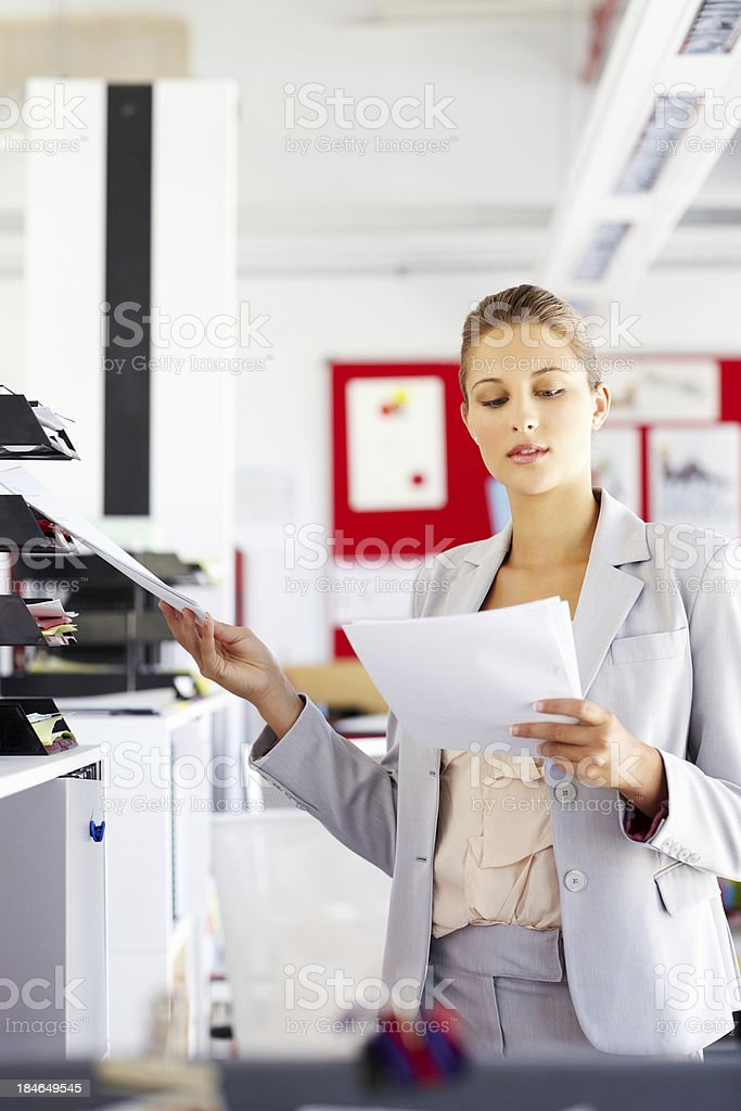 Businesswoman Filing Papers royalty-free stock photo