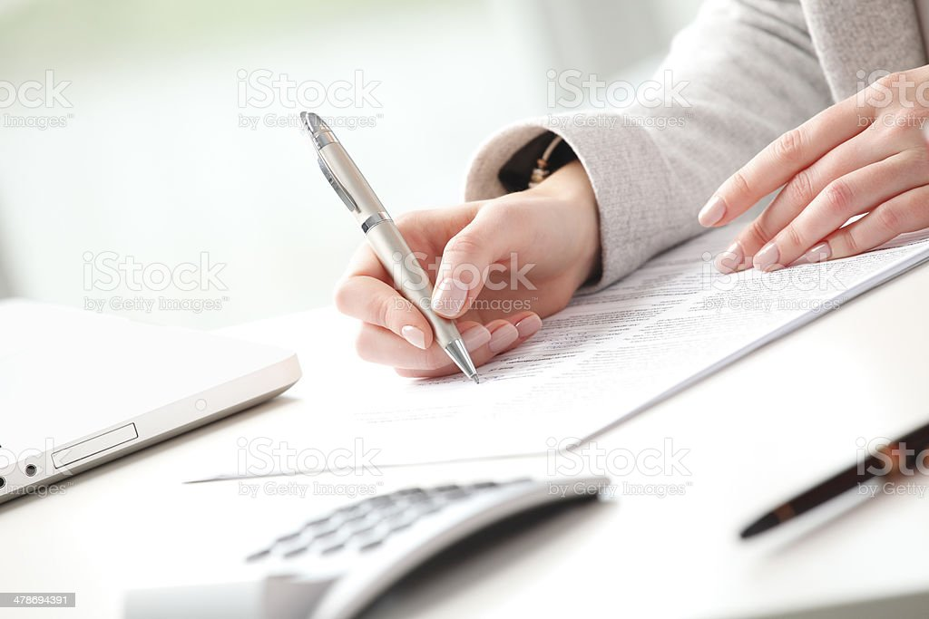 Businesswoman fill the form stock photo