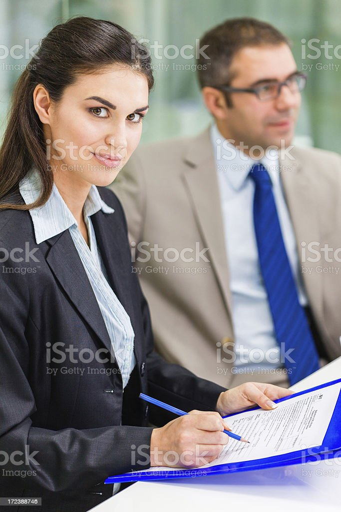 Businesswoman filling application form royalty-free stock photo