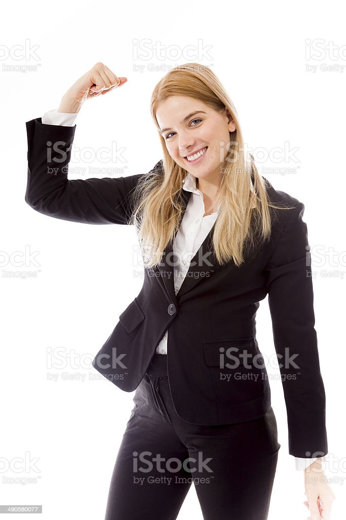 Businesswoman flexing her biceps stock photo