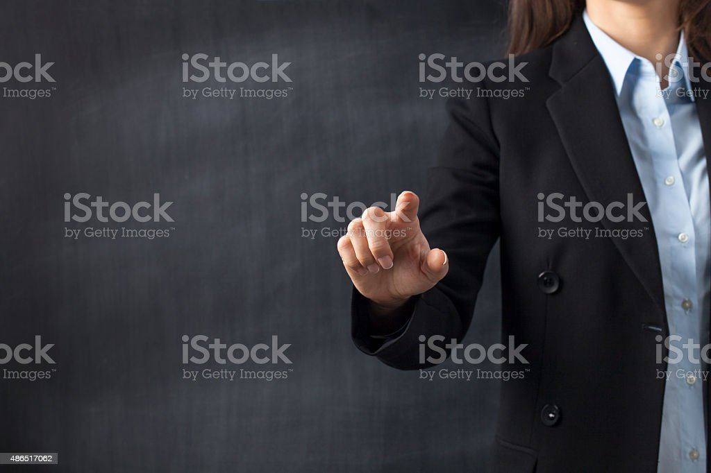 Businesswoman front of Blackboard stock photo