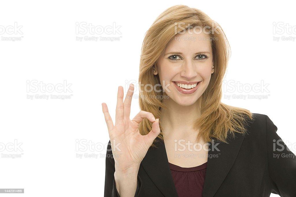 Businesswoman gestures 'ok' royalty-free stock photo