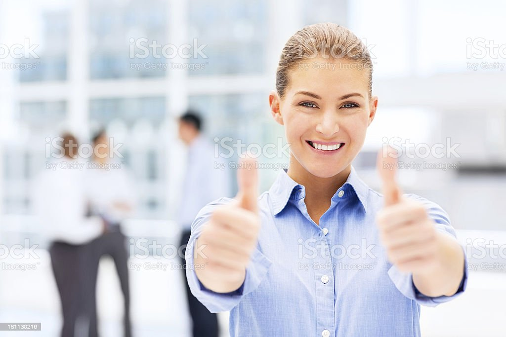 Businesswoman Gesturing Thumbs Up royalty-free stock photo