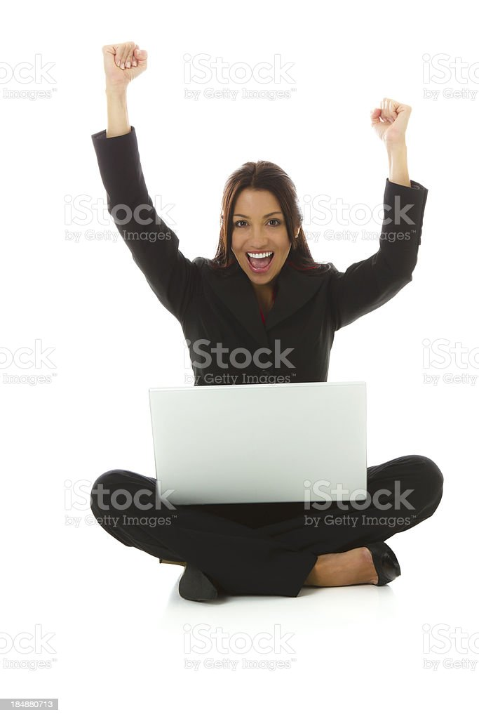 Businesswoman gesturing with both fists stock photo