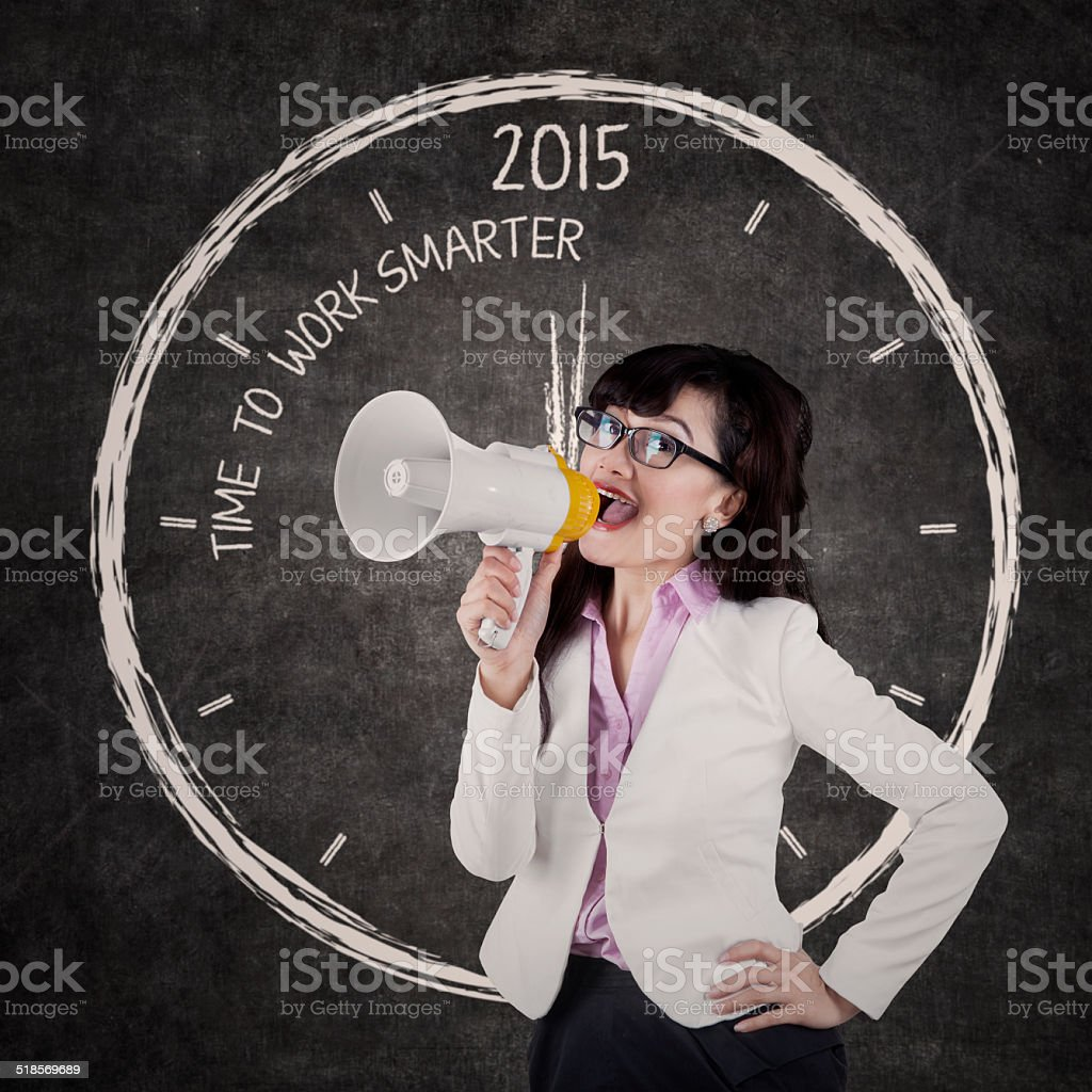 Businesswoman give order to work smarter stock photo