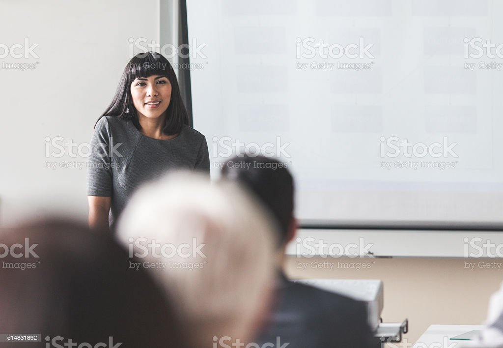 Businesswoman giving a presentation stock photo