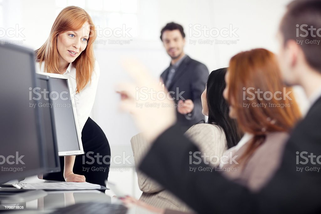 businesswoman giving a presentation  to his team royalty-free stock photo
