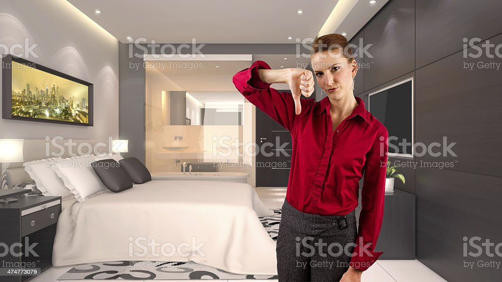 Businesswoman Giving Bad Rating of Unsatisfactory Hotel stock photo