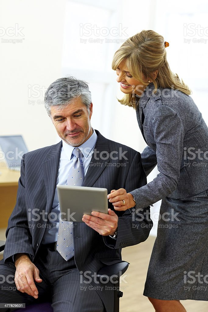 Businesswoman giving demonstrating on digital tablet to her partner royalty-free stock photo