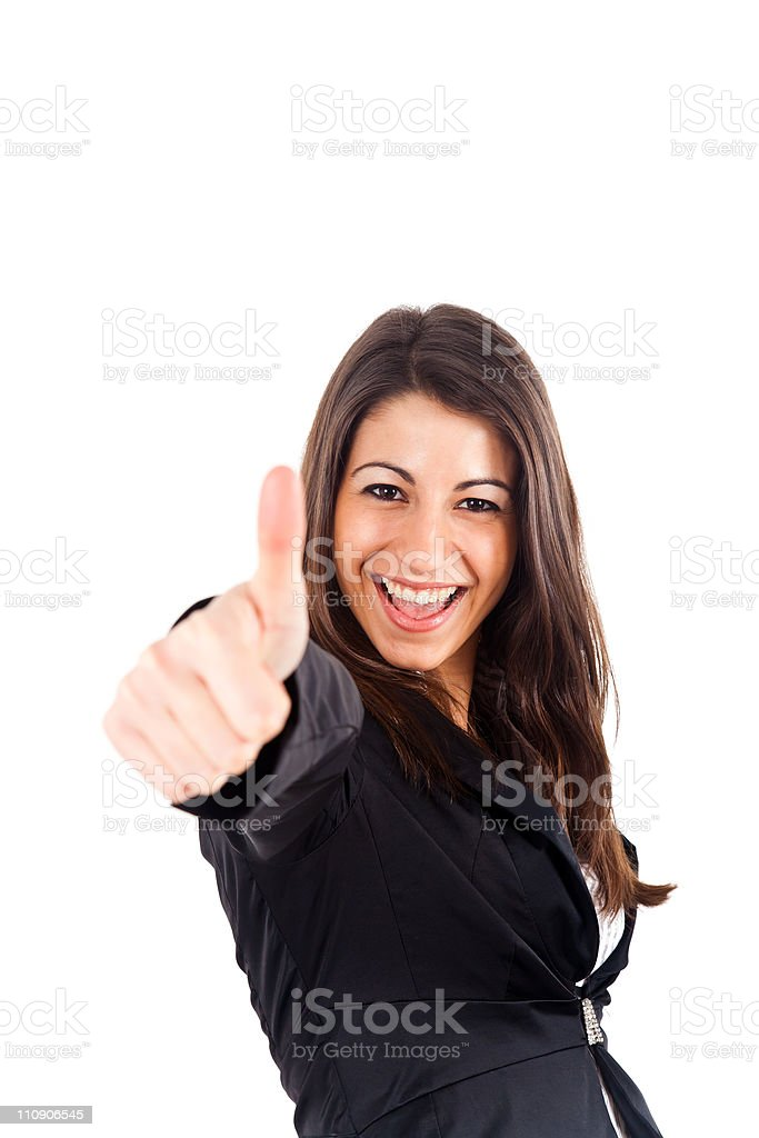 Businesswoman giving thumbs up for approval royalty-free stock photo