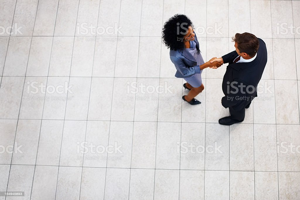 Businesswoman greeting male partner royalty-free stock photo