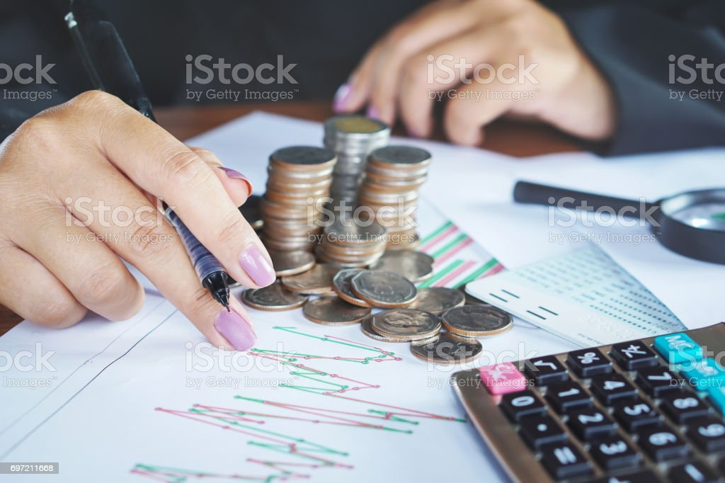 businesswoman hand analyzing on financial graph stock photo