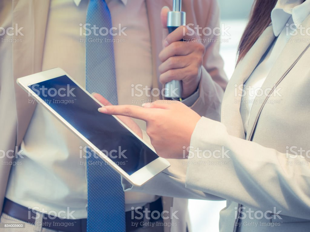 Businesswoman hand during discussion of important contents in a digital tablet. Business and economy concept. stock photo