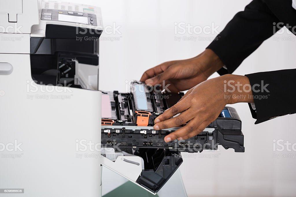 Businesswoman Hand Fixing Photocopy Machine stock photo
