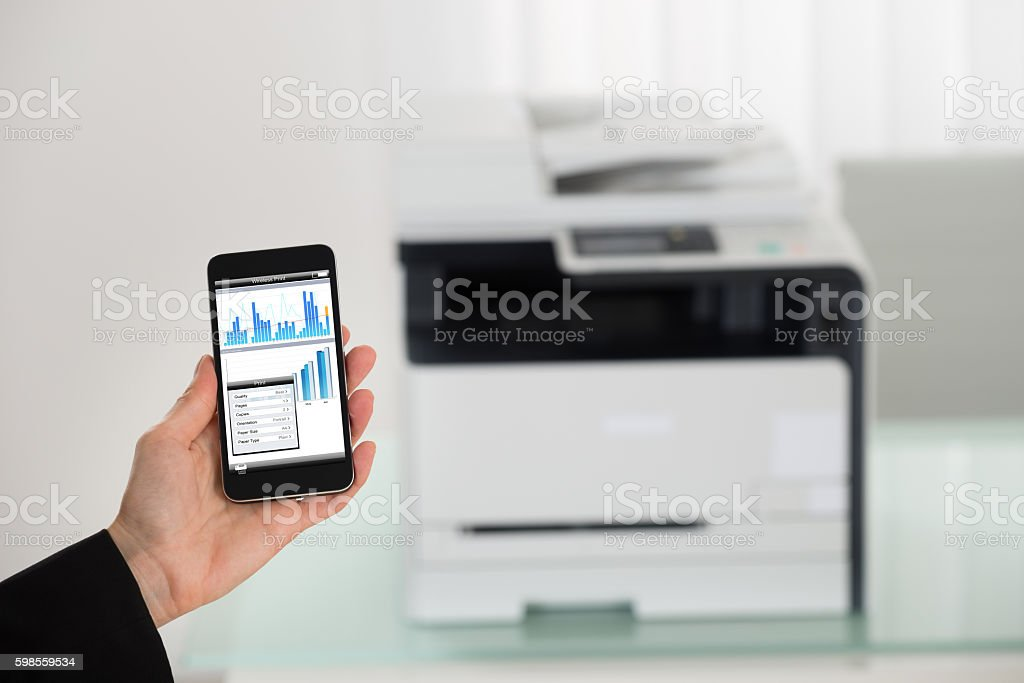 Businesswoman Hand Giving Print Command On Smart Phone stock photo
