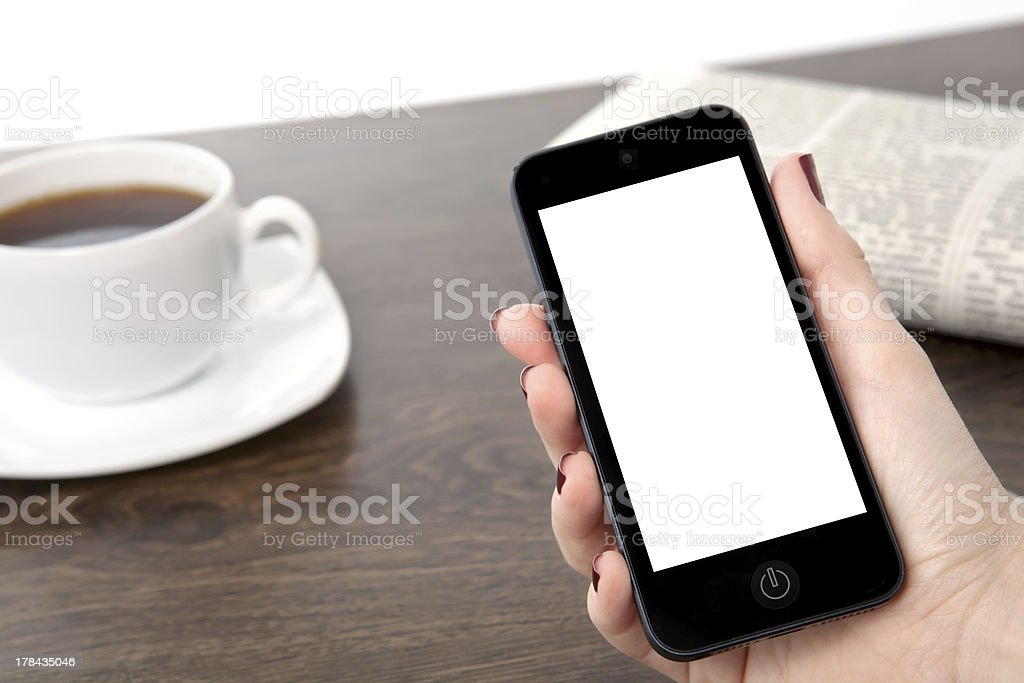businesswoman hand holding a phone against the isolated background royalty-free stock photo