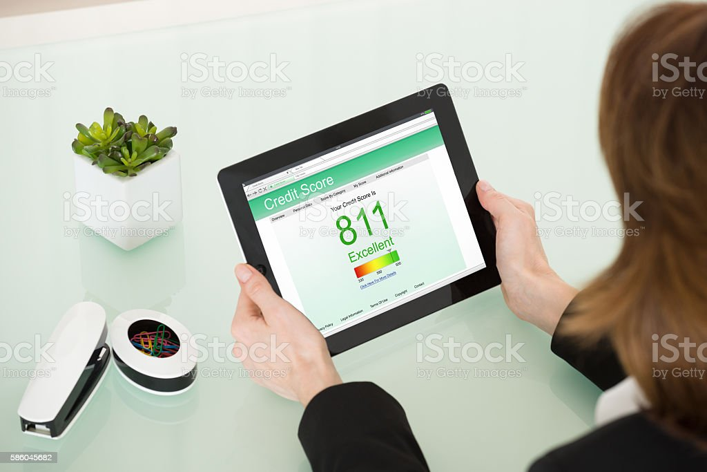 Businesswoman Hand With Digital Tablet Showing Credit Score stock photo