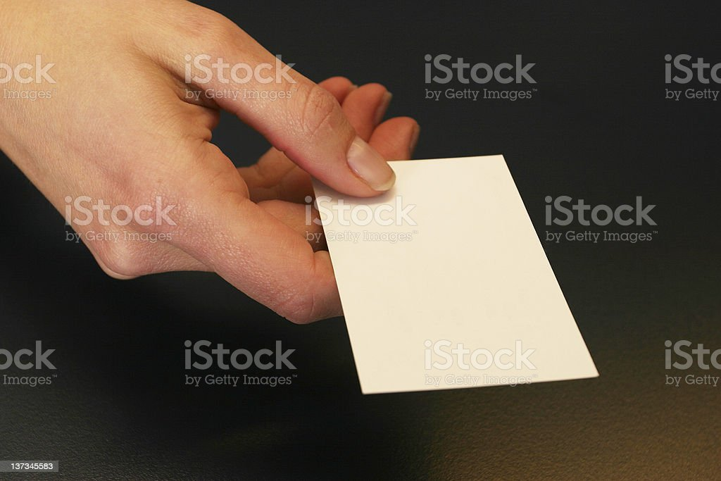Businesswoman handing her card royalty-free stock photo