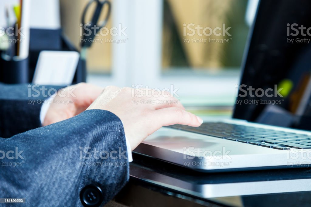 Businesswoman hands close-up on laptop - writing royalty-free stock photo