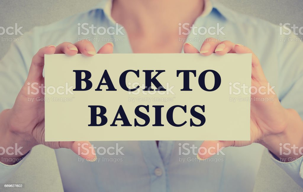 businesswoman hands holding white card sign note with back to basics text message stock photo