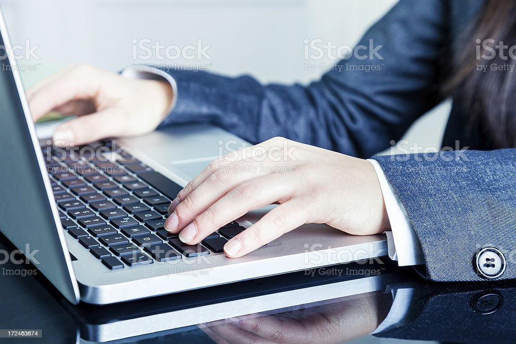 Businesswoman hands on laptop - writing royalty-free stock photo