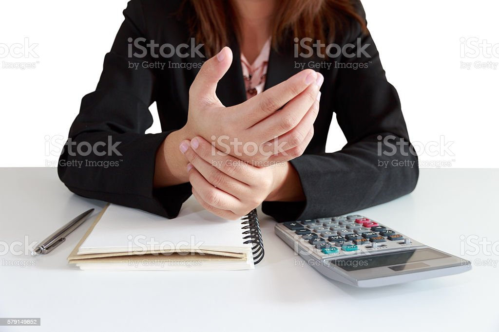 Businesswoman hands pain on desk office syndrome stock photo