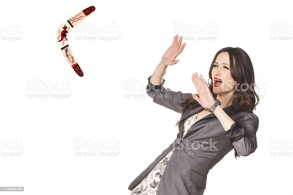 Businesswoman has a boomerang coming back at her stock photo