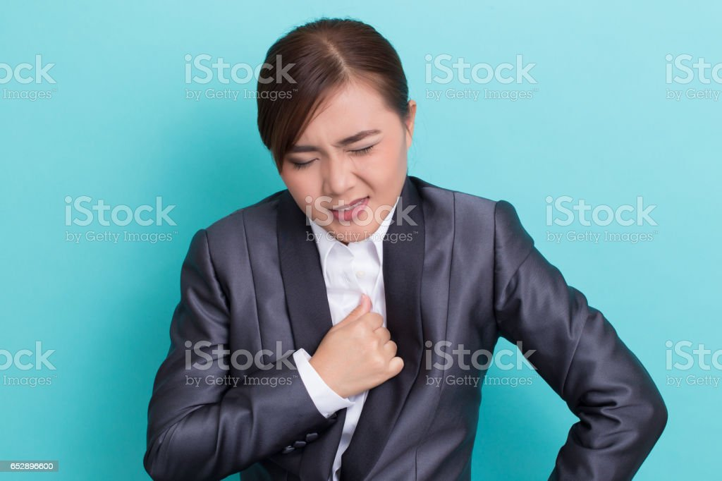 Businesswoman has chest pain stock photo