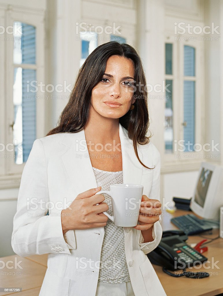 Businesswoman having a coffee stock photo