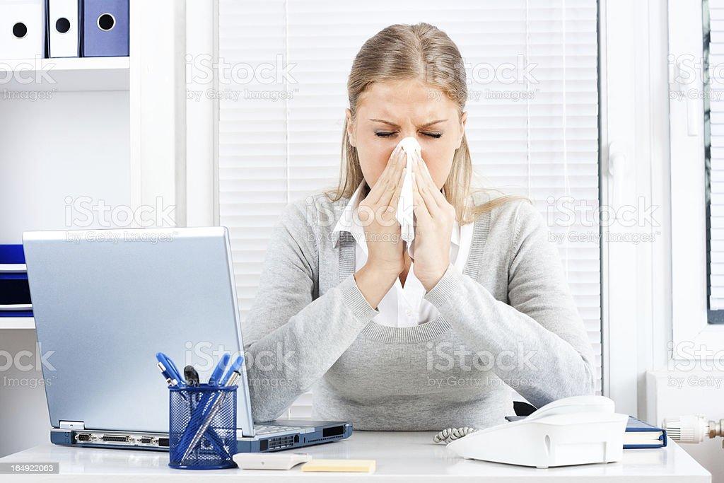 Businesswoman having flu stock photo